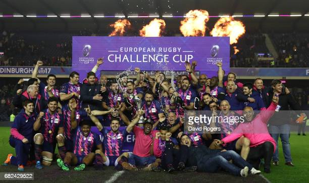 Stade Francais players celebrate following their 2517 victory during the European Rugby Challenge Cup Final between Gloucester and Stade Francais at...