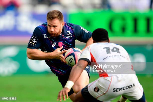 Stade Francais' South Africa hooker Craig Burden vies with Oyonnox's players during the Top 14 rugby union match between Stade Francais Paris and...