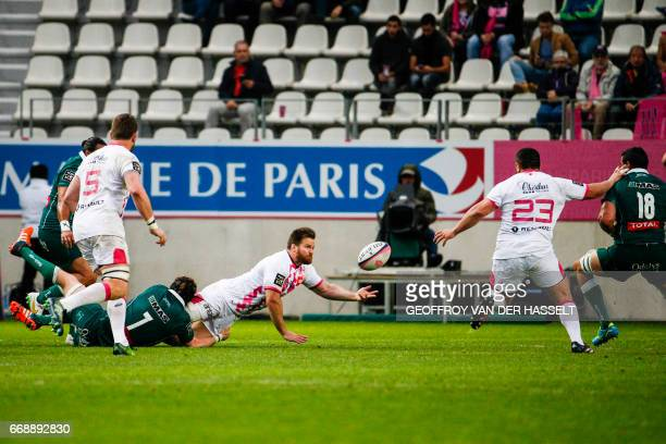 Stade Francais South African Craig Burden is tackled by Paus Prop French Jeremy Hurou during the French Top 14 rugby union match between Stade...
