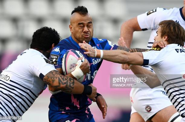Stade Francais' Tongan full-back Telusa Veainu is tackled by Bordeaux-Begles' Samoan flanker Afa Amosa during the French Top 14 rugby union match...