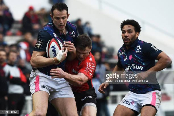 Stade Francais's French second row Alexandre Flanquart vies with RC Toulon's French winger Chris Ashton during the French Top 14 rugby union match...