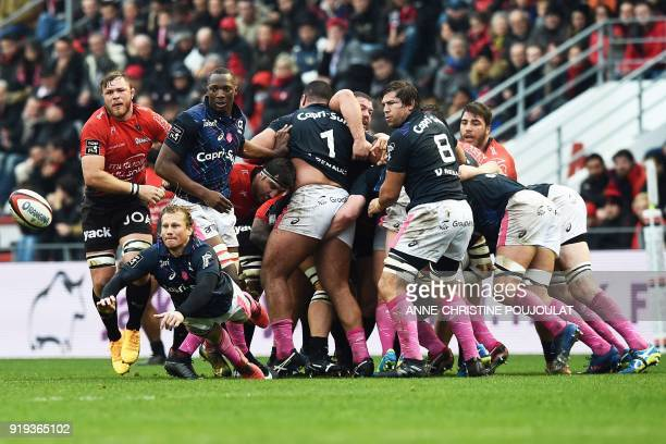 Stade Francais's OSuth African scrumhalf Charl McLeod takes the ball out of the scrum during the French Top 14 rugby union match Toulon vs Stade...