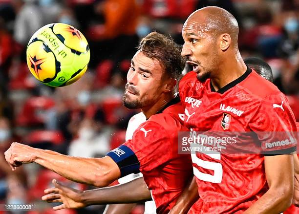 Stade Rennais' French defender Damien Da Silva and Stade Rennais' French midfielder Steven Nzonzi eye the ball during the French L1 football match...