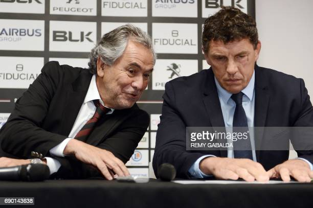 Stade Toulousain Rugby club president Jean Rene Bouscatel and former Toulouse player Didier Lacroix react during a press conference announcing...