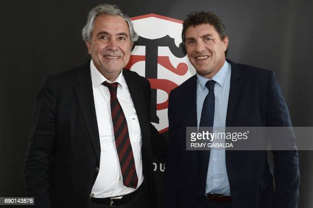 Stade Toulousain Rugby club president Jean Rene Bouscatel and former Toulouse player Didier Lacroix pose after a press conference announcing Lacroix...