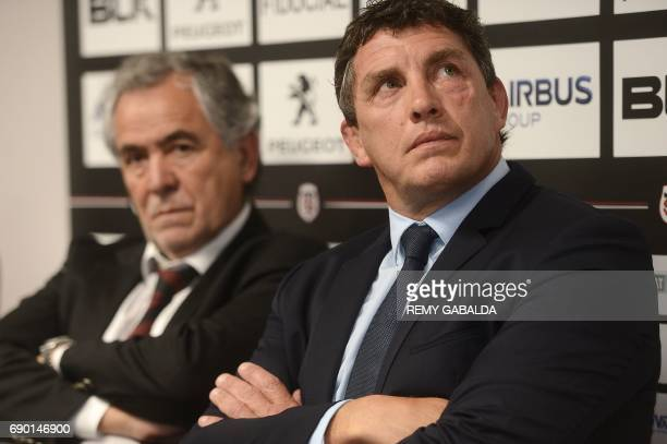 Stade Toulousain Rugby club president Jean Rene Bouscatel and former Toulouse player Didier Lacroix look on during a press conference announcing...
