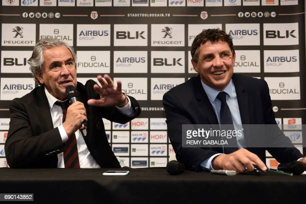 Stade Toulousain Rugby club president Jean Rene Bouscatel flanked by former Toulouse player Didier Lacroix speaks during a press conference...
