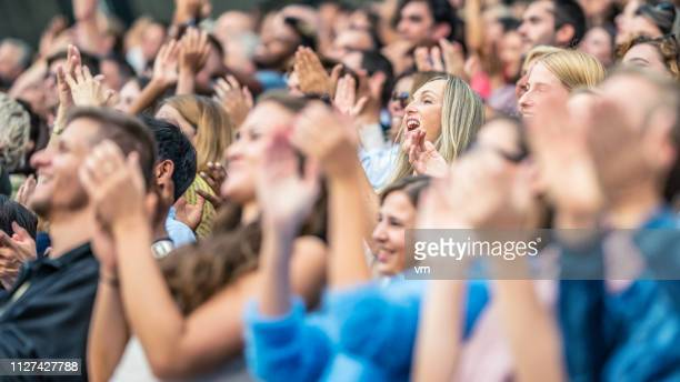 stadium crowd cheering and clapping - cheering stock pictures, royalty-free photos & images