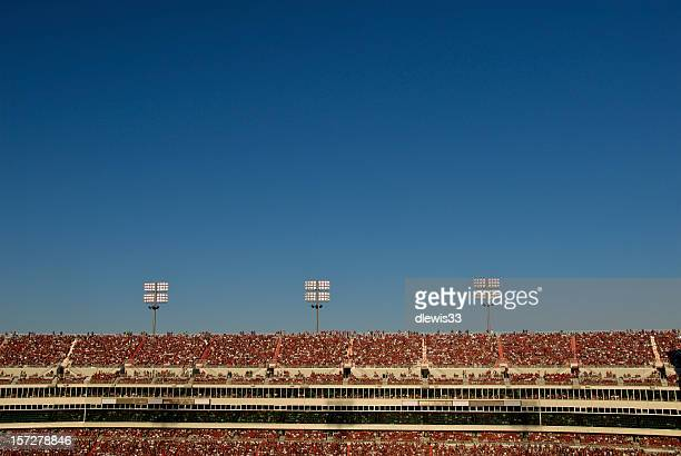 Stadium Crowd Under Blue Sky