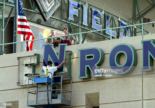 Stadium employees remove letters from one of the Enron Field signs March 21 2002 in Houston TX The Houston Astros paid $21 million to get back the...
