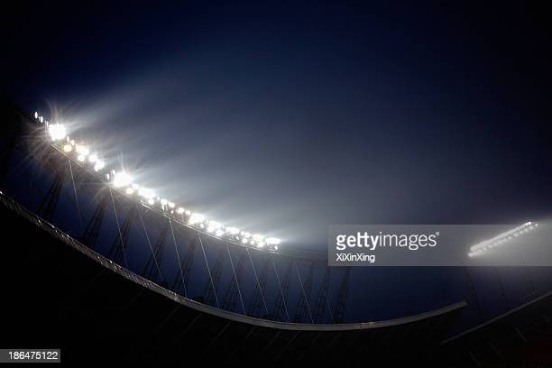 stadium floodlights at night time, beijing, china - stadio foto e immagini stock