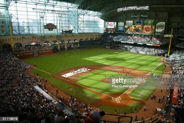 Stadium ground crew prepare the infield prior to the 2004 Major League Baseball AllStar Game at Minute Maid Park on July 13 2004 in Houston Texas