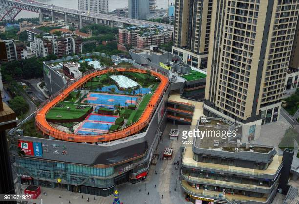 A stadium is seen on the rooftop of a shopping mall at Nan'an District on May 23 2018 in Chongqing China The stadium covers an area of 17000 square...