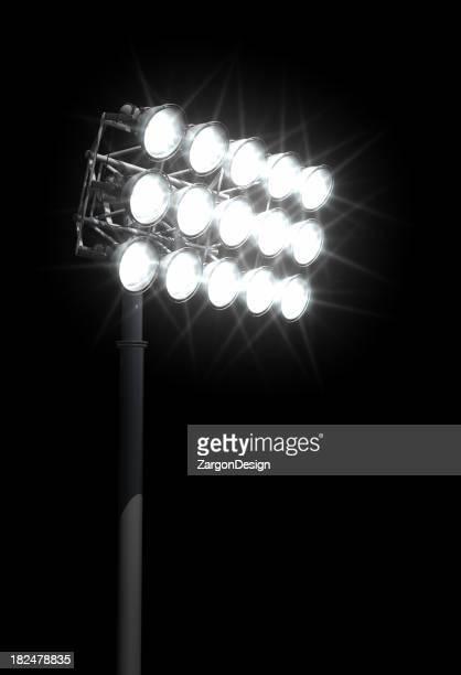 Stadium lights aimed down at the football field