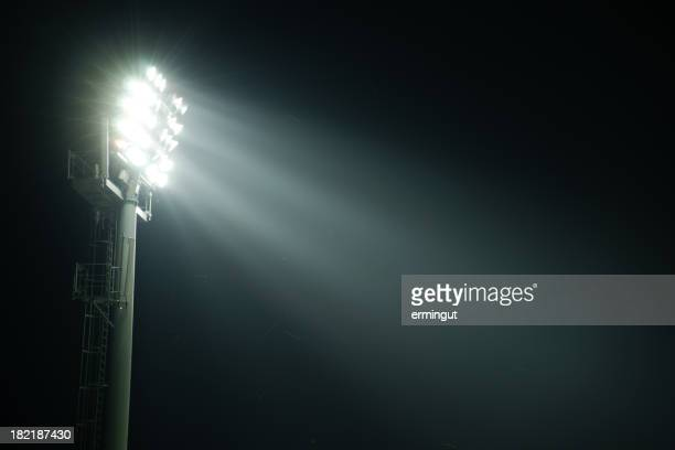 A stadium lights at night from the side