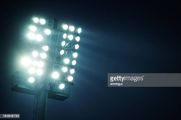 stadium lights  - front view - stadium lights stock photos and pictures