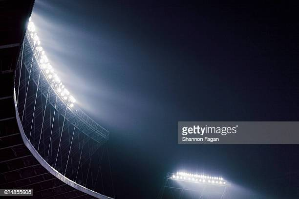 Stadium lights glowing against night sky