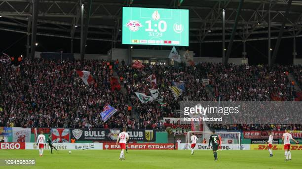 Stadium overview / Fans of Leipzig / Scoreboard during the DFB Cup between RB Leipzig and VfL Wolfsburg at Red Bull Arena on February 06, 2019 in...