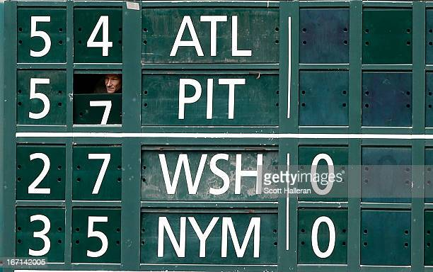 A stadium scoreboard worker is seen prior to the start of the game between the Cleveland Indians and Houston Astros and the Cleveland Indians at...