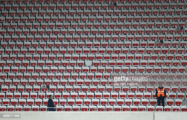 Stadium seats are seen empty after a clash between supporters during the French L1 football match between Nice and Evian Thonon on April 4 2015 at...