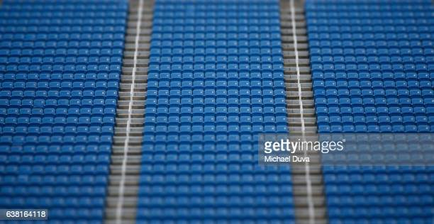 stadium seats in a stadium with stairs and railings - empty bleachers stock photos and pictures