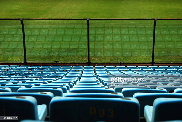 stadium seats - empty bleachers stockfoto's en -beelden