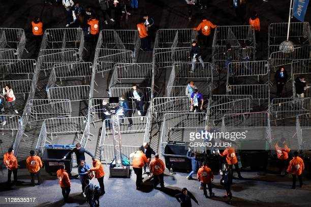 Stadium security employees frisk football supporters at an entrance before the French L1 football match between Olympique de Marseille and AS...