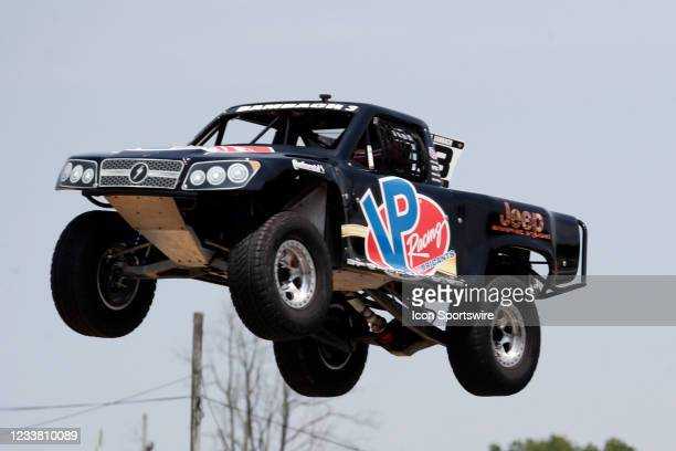 Stadium Super Trucks driver Aaron Bambach goes airborne on the front straightaway after launching off a ramp during The Speed Energy Stadium...