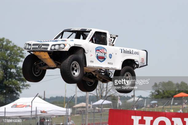 Stadium Super Trucks driver Bill Hynes goes airborne on the front straightaway after launching off a ramp during The Speed Energy Stadium SuperTrucks...
