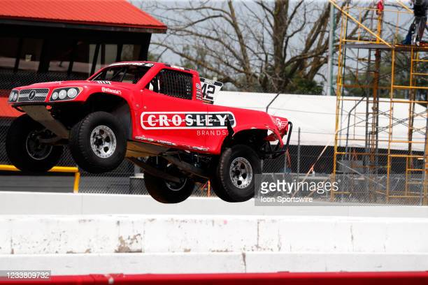 Stadium Super Trucks driver Bo Lemastus goes airborne on the front straightaway after launching off a ramp during The Speed Energy Stadium...