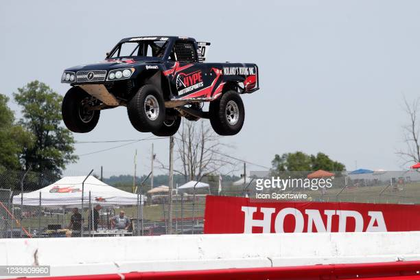 Stadium Super Trucks driver Jeff Noland goes airborne on the front straightaway after launching off a ramp during The Speed Energy Stadium...