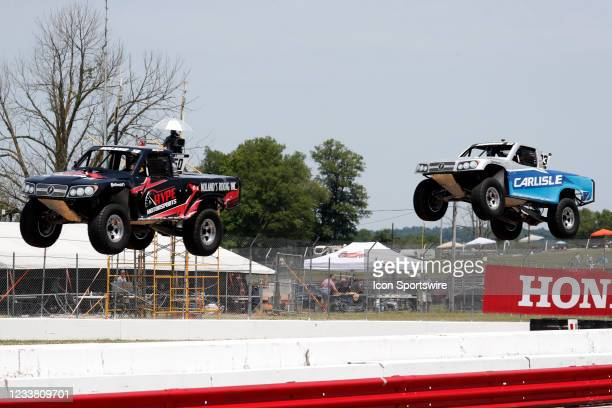 Stadium Super Trucks driver Jeff Noland is in front of Mat Brabham as their trucks go airborne on the front straightaway after launching off a ramp...