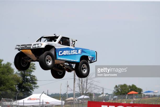 Stadium Super Trucks driver Matt Brabham goes airborne on the front straightaway after launching off a ramp during The Speed Energy Stadium...
