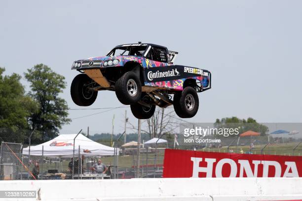 Stadium Super Trucks driver Max Gordon goes airborne on the front straightaway after launching off a ramp during The Speed Energy Stadium SuperTrucks...