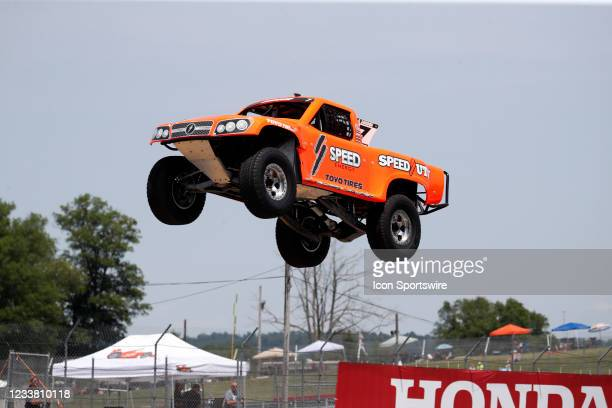Stadium Super Trucks driver Robby Gordon goes airborne on the front straightaway after launching off a ramp during The Speed Energy Stadium...