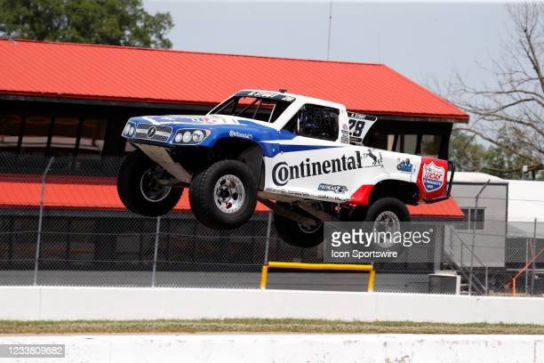 Stadium Super Trucks driver Robert Stout goes airborne on the front straightaway after launching off a ramp during The Speed Energy Stadium...