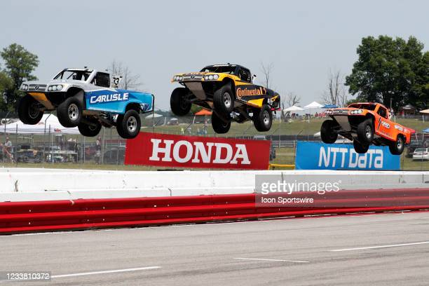 Stadium Super Trucks drivers Matt Brabham and Jerrett Brooks and Robby Gordon race on the front straightaway and go airborne after launching off a...