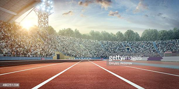 stadium with running tracks - athletics stock photos and pictures