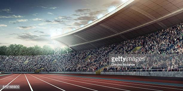 . stadium with running tracks - sports track stock pictures, royalty-free photos & images