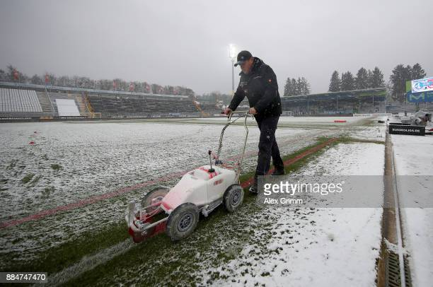 A stadium worker prepars the pitch before the Second Bundesliga match between SV Darmstadt 98 and SSV Jahn Regensburg at JonathanHeimesStadion am...