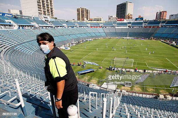 A stadium worker wears a surgical mask during the soccer match between Cruz Azul and Indios in a stadium empty of fans on May 2 2009 in Mexico City...