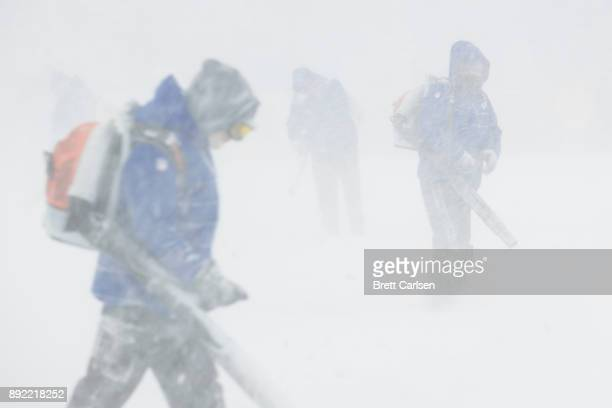 Stadium workers use Stihl equipment to remove snow from the yard lines on the field during the game between the Buffalo Bills and the Indianapolis...