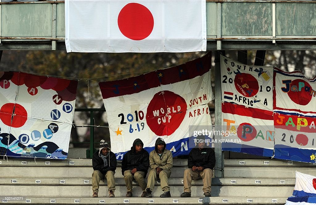 Stadium workers watches Japan's training session at Outeniqua stadium in George, on June 16, 2010. Japan beat Cameroon in their first match and faces the Netherlands in Durban on June 19.