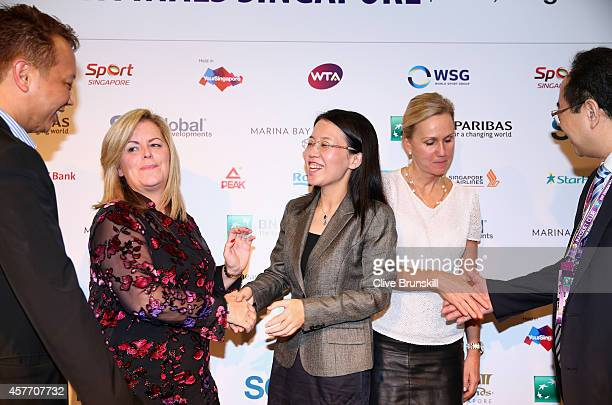 Staecy Allaster WTA CEO and Chairman shakes hands with Lydia Long Vice Mayor of Zhuhai at the press conference for the WTA Elite Trophy in Zhuhai...