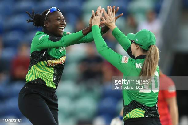Stafanie Taylor and Amanda-Jade Wellington of Southern Brave celebrate the wicket of Bryony Smith of Welsh Fire during The Hundred match between...
