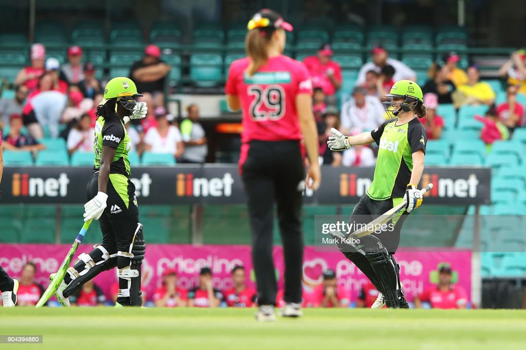 Stafanie Taylor and Rene Farrell of the Thunder celebrate victory during the Women's Big Bash League match between the Sydney Sixers and the Sydney Thunder at Sydney Cricket Ground on January 13, 2018 in Sydney, Australia.