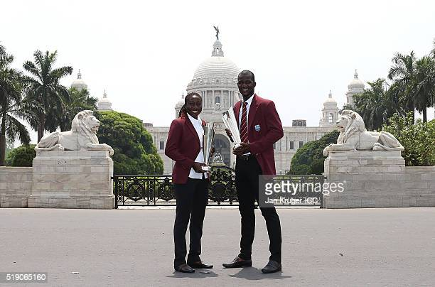 Stafanie Taylor Captain of the West Indies and Darren Sammy Captain of the West Indies pos with the trophies during a photocall after winning the...