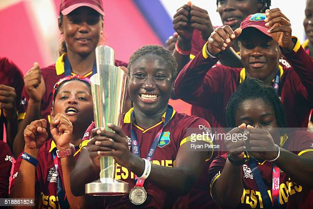 Stafanie Taylor Captain of the West Indies celebrates with the trophy during the Women's ICC World Twenty20 India 2016 Final match between Australia...