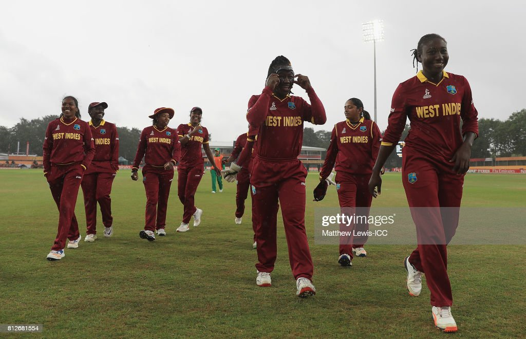 Stafanie Taylor, Captain of the West Indies leads her team off the field of play, after rain stops play during the ICC Women's World Cup 2017 match between West Indies and Pakistan at Grace Road on July 11, 2017 in Leicester, England.