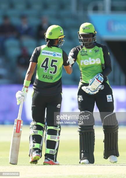 Stafanie Taylor of the Thunder and Harmanpreet Kaur of the Thunder celebrate victory in the Women's Big Bash League match between the Hobart...